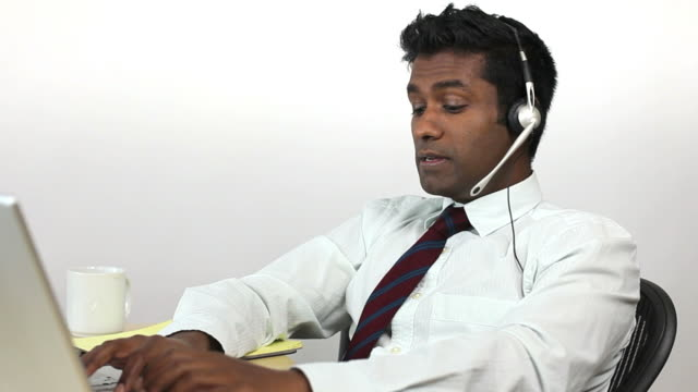 charismatic guy on headset, animated - bluetooth stock videos & royalty-free footage