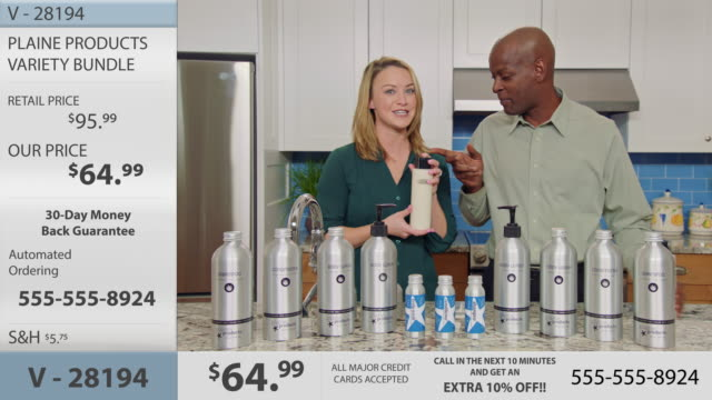charismatic man and woman demonstrate eco-friendly body lotion product in modern kitchen setting on television infomercial. - hair conditioner stock videos and b-roll footage