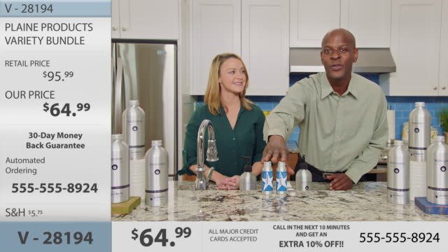 charismatic man and woman sample, promote and display eco-friendly body and hair care products in modern infomercial. - home shopping stock videos & royalty-free footage