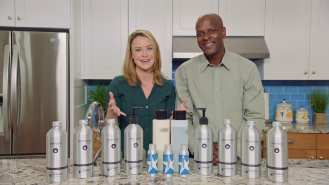 charismatic man and women discuss the great value and sustainable benefits of plaine-brand eco-friendly hair and body products in infomercial format. - hair conditioner stock videos and b-roll footage