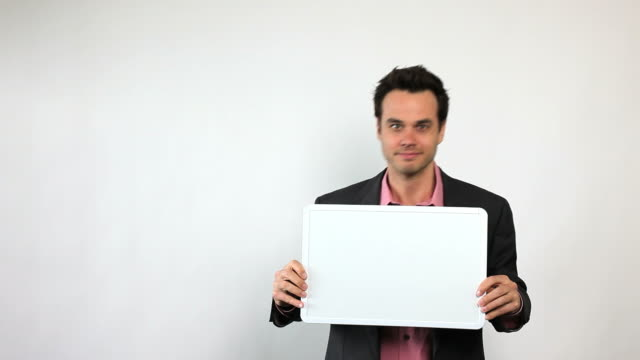 charismatic sales guy holding white board, having fun! - sign stock videos & royalty-free footage