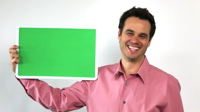 charismatic sales guy with green screen board, laughing - salesman stock videos and b-roll footage