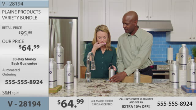 charismatic woman dispenses hand soap and enjoys fragrance before washing hands in modern kitchen setting on television infomercial. - hair conditioner stock videos and b-roll footage