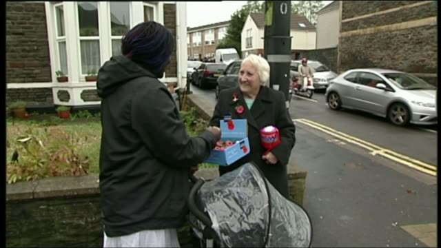 charities to be investigated over data selling claims lib various shots of olive cooke collecting money for poppies on street end lib - リチャード・パロット点の映像素材/bロール