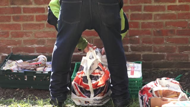 charity based in kingston, london, has started to distribute free food donated by the local aldi supermarket to residents in the area during the... - essential services stock videos & royalty-free footage