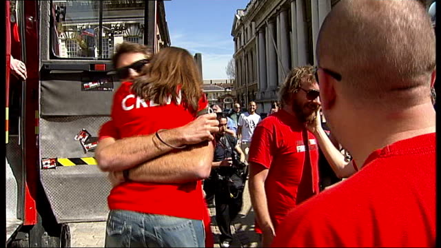 charity fundraisers complete roundtheworld trip in a fire engine england london greenwich old royal naval college moore and other members of... - royal navy college greenwich stock videos & royalty-free footage