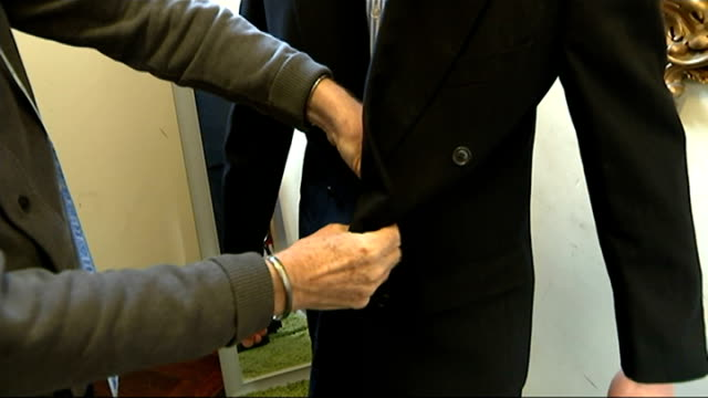 charity gives the unemployed suits for interviews; reporter to camera sot racks of shirts ties on hanger labels on rack of jackets various of... - all shirts stock-videos und b-roll-filmmaterial
