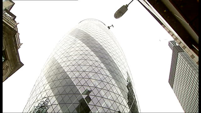man climbs up the gherkin wearing diving suit england london ext lloyd scott putting on 1940's diving suit before climbing the 38 floors of the... - diving helmet stock videos and b-roll footage