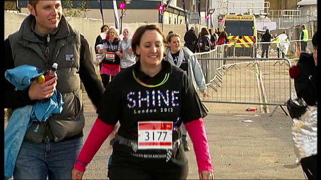 marathon walk raises money for cancer research england london battersea ext charity walkers along some wearing 'shine' t shirts and / two women along... - hair accessory stock videos & royalty-free footage