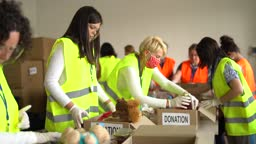 Charity organisation  Collecting Food Donations In Warehouse in Time of Pandemic