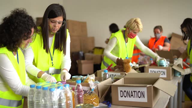 charity organisation  collecting food donations in warehouse in time of pandemic - poverty stock videos & royalty-free footage