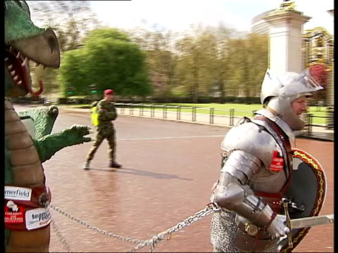 charity runner lloyd scott completes course england london ext lloyd scott wearing st george costume including suit of armour dragging dragon behind... - suit of armour stock videos and b-roll footage