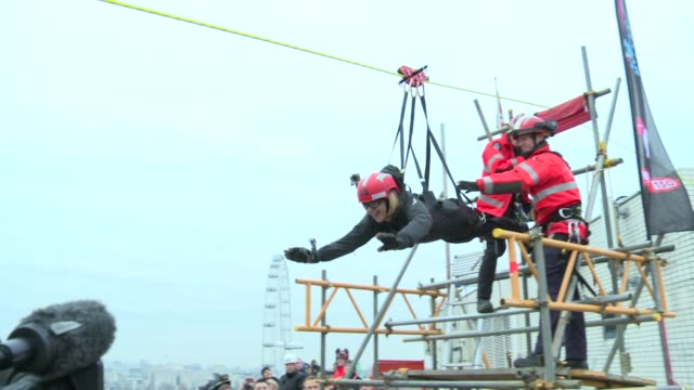 charity zip wire ride across river thames england london ext river thames and zip wire / bbc london reporter getting ready and crossing thames on the... - nursing assistant stock videos and b-roll footage