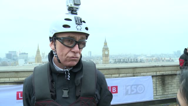 charity zip wire ride across river thames ron dobson getting ready for crossing / ron dobson interview sot / ron dobson gvs / shaun fox interview sot... - brigade stock videos and b-roll footage