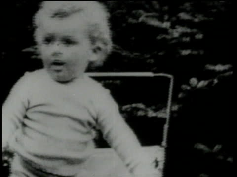 charles and anne morrow lindbergh / baby charlie lindbergh / nurse pushing baby carriage with dog running along - charles lindbergh stock videos & royalty-free footage