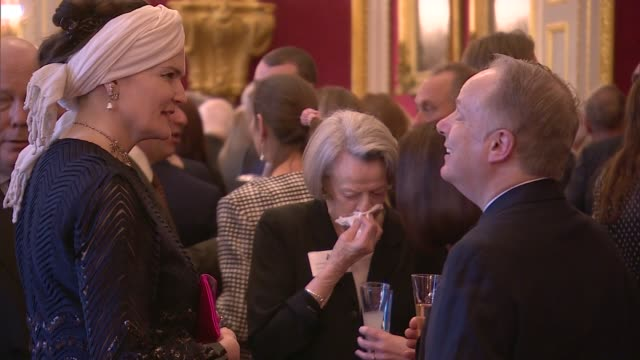 charles and camilla host reception for british oscar winners; general views canapes served to guests / camilla chatting with guests / maggie smith... - julian fellowes stock videos & royalty-free footage