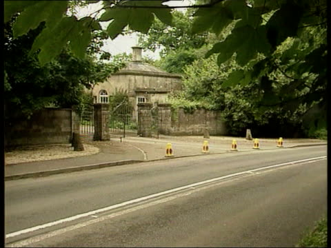 Charles and Camilla relationship LIB Highgrove EXT Police cones outside gates to Highgrove GV Highgrove house