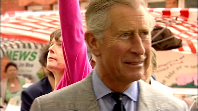 charles and camilla visit isle of wight prince charles chatting with stallholder selling vegetables laughs as gust of wind blows stall - isle of wight stock videos & royalty-free footage