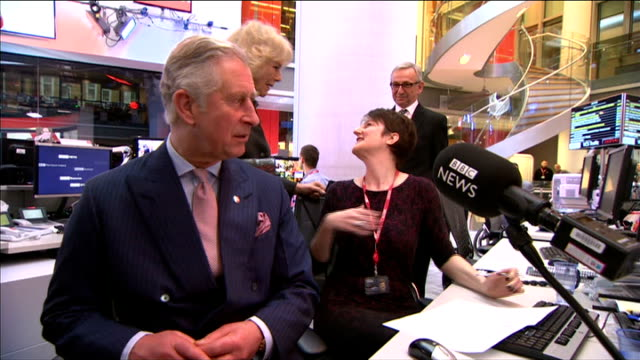 vídeos de stock e filmes b-roll de charles and camilla visit new broadcasting house prince charles sat at news desk as camilla watches / charles and camilla chat to female newsreader... - shirley temple