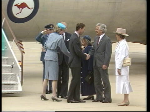 Day 9 AUSTRALIA Canberra Bob Hawke Australian PM PULL OUT to wife Hazel Hawke as they move along line towards chatting CMS Hawke smiling LMS Prince...