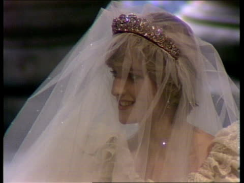 charles and diana wedding: diary of the day: part three; england: london: st paul's cathedral: int cms in tms l-r bridesmaids l-r tbv up aisle clergy... - チャールズ皇太子点の映像素材/bロール