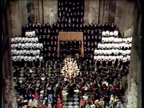 charles and diana wedding: diary of the day: part three; england: london: st paul's cathedral: int lv royals sing archbishop runcie leads couple l-r... - チャールズ皇太子点の映像素材/bロール