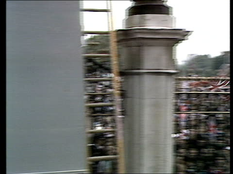 charles and diana wedding: live special: part five: buckingham palace balcony and crowds:; england: london: ext carol barnes to camera outside... - wedding stock videos & royalty-free footage