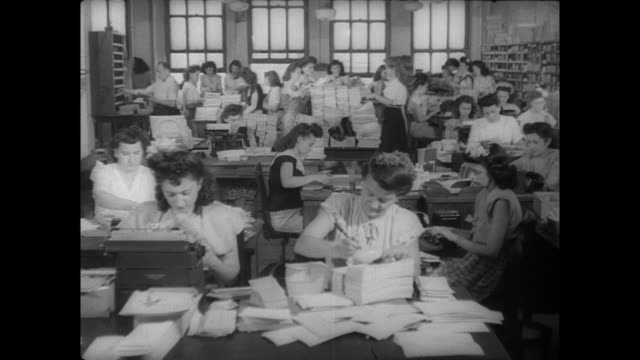 charles atlas memorabilia in office / women working in office mailing fan letters and pamphlets - charles atlas bildbanksvideor och videomaterial från bakom kulisserna