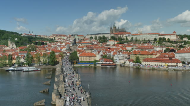 charles bridge, prague castle and st. vitus's cathedral, prague - river vltava stock videos & royalty-free footage