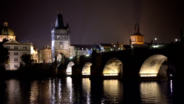 charles bridge view from prague boats cruises at night - charles bridge stock videos & royalty-free footage