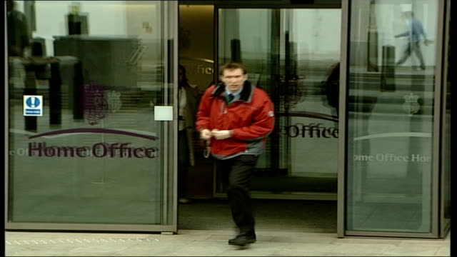 charles clarke offers to resign home office ext close shot of 'home office' sign staff leaving through glass doors at home office entrance clean feed... - charles clarke britischer politiker stock-videos und b-roll-filmmaterial