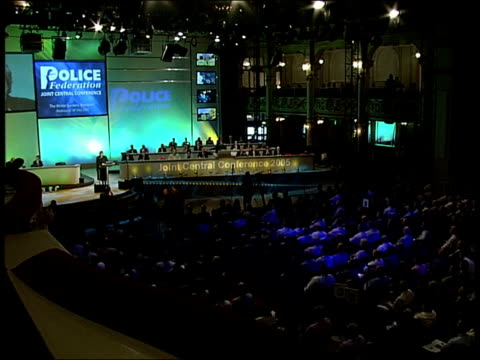 charles clarke speaks at police federation's annual conference; england: blackpool: police federation annual conference: int large screen showing... - bureaucracy stock videos & royalty-free footage