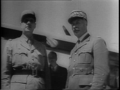 charles de gaulle and henri giraud meet in algiers to outline the future of the french republic / they pose near plane on airfield walk past camera /... - charles de gaulle stock videos & royalty-free footage