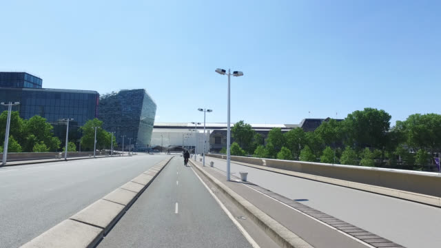 charles de gaulle bridge paris without traffic and only two cyclists and two pedestrians may 6 2020 in paris france - four people stock videos & royalty-free footage