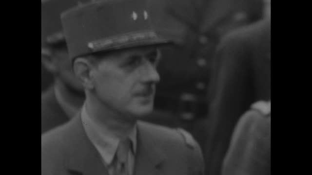 vs charles de gaulle marching defeated german officers / gen dwight eisenhower talks with french officers he's followed by happy parisians at base of... - prigioniero di guerra video stock e b–roll