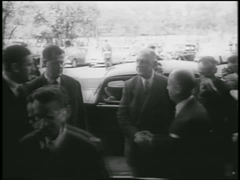 charles de gaulle shaking hands with men entering building / return to premiership - 1958 stock videos & royalty-free footage