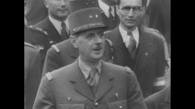 vídeos de stock e filmes b-roll de charles de gaulle walking with officials down crowded street / de gaulle and officers in car / officer's helmet and police on motorcycles from... - nazismo