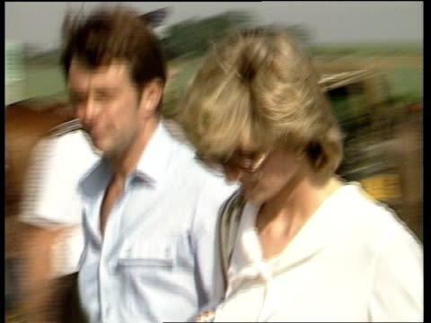stockvideo's en b-roll-footage met 2nd anniv charles diana 2nd anniv england sussex cowdray park in polo ponies lms man by charles' car lms prince charles by car boot diana and man... - prinses
