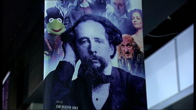 charles dickens bicentenary celebrations: dickens on stage and screen; london: south bank: ext / night banner advertising dickens season outside... - charles dickens stock videos & royalty-free footage