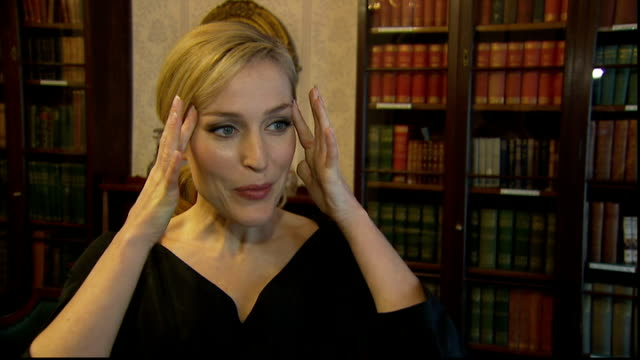 gillian anderson interview anderson interview sot on playing miss havisham / previous adaptations portrayed as being old but that's through pip's... - charles dickens stock videos & royalty-free footage