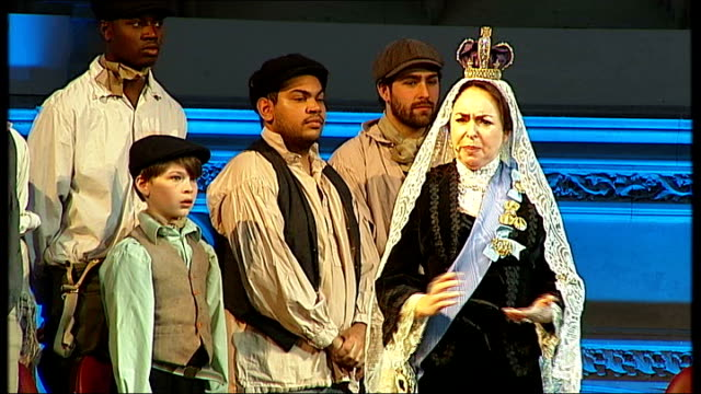 charles dickens bicentenary celebrations: guildhall performance in front of queen elizabeth; cutaway actress dressed as queen victoria singing sot - charles dickens stock videos & royalty-free footage