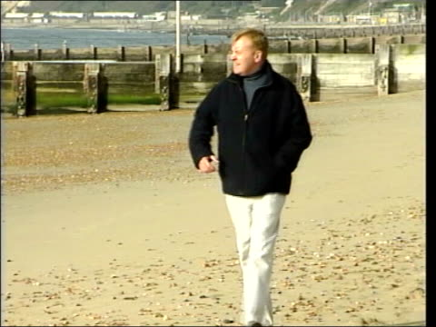 charles kennedy admits drink problem / calls for leadership election r21090401 bournemouth charles kennedy mp walking along beach - charles kennedy stock videos & royalty-free footage