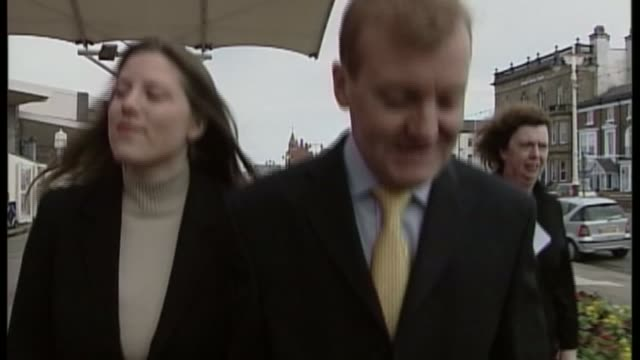 stockvideo's en b-roll-footage met charles kennedy dies aged 55 lib kennedy towards with his wife sarah gurling as interviewed about stomach bug and he replies sot it seems to have... - southport engeland