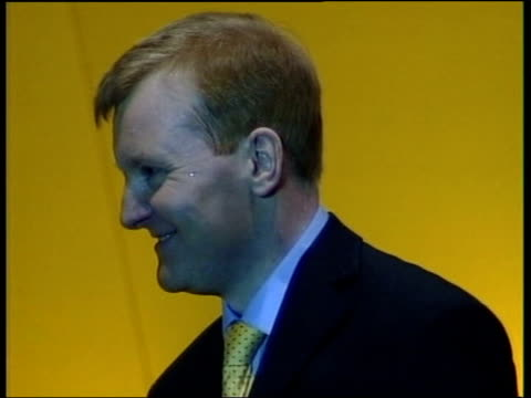 stockvideo's en b-roll-footage met drink problem rumours lib lancashire southport charles kennedy mp on stage at party conference blowing a kiss to audience and looking hot - southport engeland