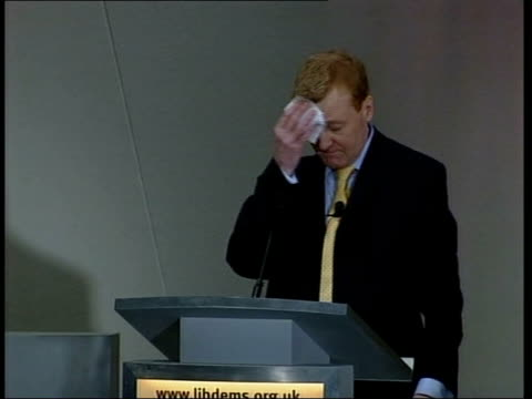stockvideo's en b-roll-footage met drink problem rumours lib lancashire southport charles kennedy mp standing behind podium at the liberal democrats spring party conference mopping... - southport engeland