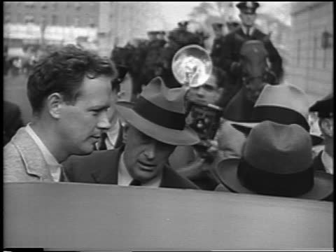charles lindbergh being interviewed by reporters outdoors at kidnapping trial / newsreel - 1935 stock videos & royalty-free footage