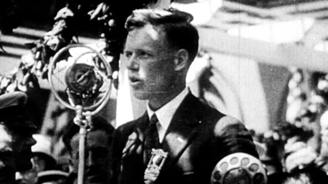 Charles Lindbergh getting into his airplane the Spirit of St Louis / airplane taking off / ticker tape parade in New York for Charles Lindbergh after...