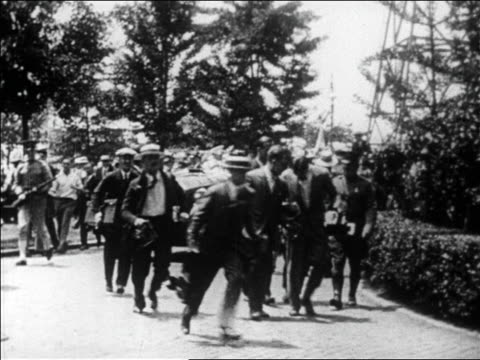 Charles Lindbergh in car moving thru crowd of admirers upon return to US / newsreel