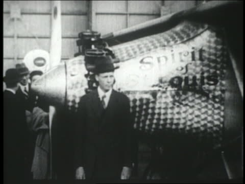 charles lindbergh in suit standing in front of spirit of st. louis airplane - anno 1927 video stock e b–roll