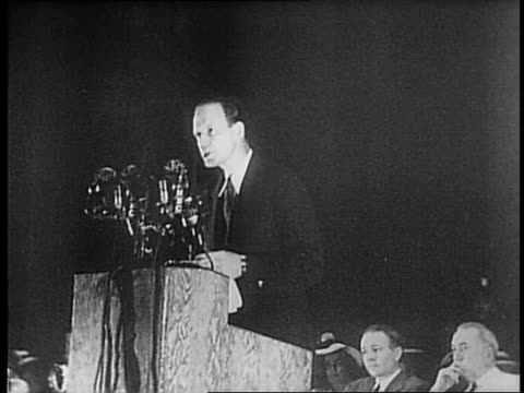 Charles Lindbergh makes statement at podium behind bank of microphones
